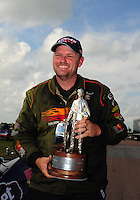 Apr. 29, 2012; Baytown, TX, USA: NHRA super gas driver Luke Bogacki celebrates after winning the Spring Nationals at Royal Purple Raceway. Mandatory Credit: Mark J. Rebilas-