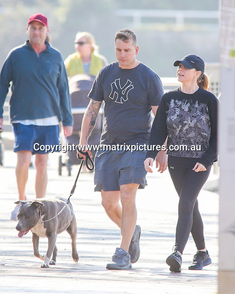 24 MAY 2018 SYDNEY AUSTRALIA<br /> WWW.MATRIXNEWS.COM.AU<br /> <br /> EXCLUSIVE PICTURES<br /> <br /> Kate Ritchie and Husband Stuart Webb  spotted putting on a PDA in a Sydney park after dropping their daughter Mae off at School.<br /> <br /> Note: All editorial images subject to the following: For editorial use only. Additional clearance required for commercial, wireless, internet or promotional use.Images may not be altered or modified. Matrix Media Group makes no representations or warranties regarding names, trademarks or logos appearing in the images. 2017 SYDNEY AUSTRALIA<br /> WWW.MATRIXNEWS.COM.AU