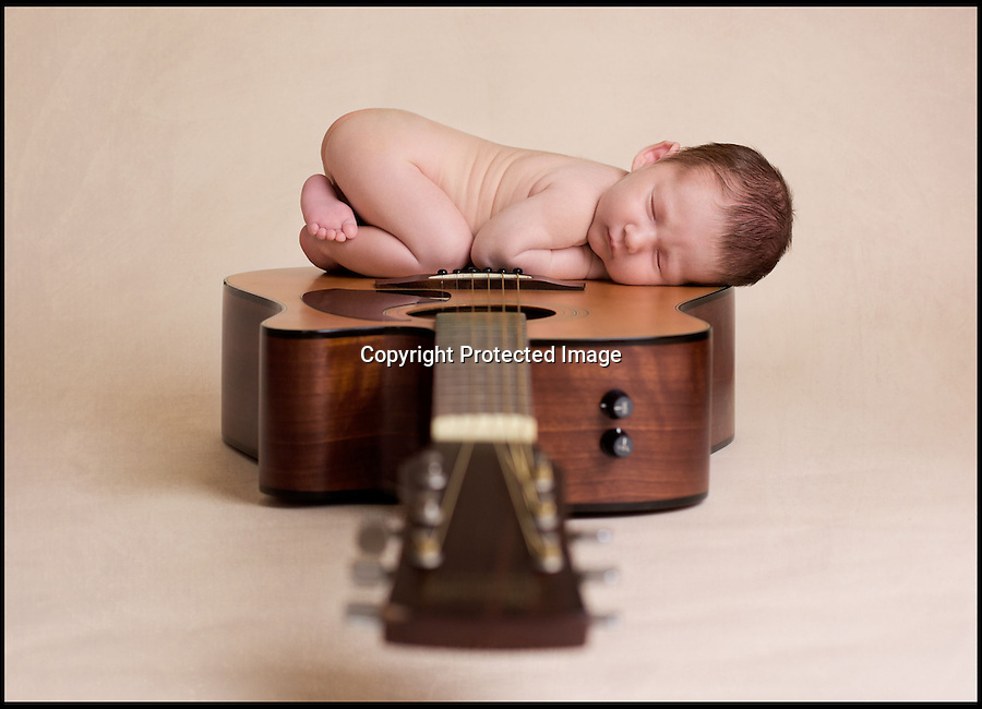 BNPS.co.uk (01202 558833)<br /> Pic: KarenWiltshire/BNPS<br /> <br /> ****Please use full byline****<br /> <br /> A photographer has captured stunning pictures of adorable newborn babies by making them fall asleep and taking shots of their expressions as they dream.<br /> <br /> Karen Wiltshire, 46, has attracted hundreds of proud parents to her studio because of her knack to take the perfect picture of the sleeping tots.<br /> <br /> In order to create the best images, she ensures the babies have eaten before they arrive and then soothes them to sleep by swaying and gently stroking their eyes.<br /> <br /> Once they are fast asleep, Karen positions them for the images on comfy throws, lying on their parents' hands, and wrapped in blankets<br /> <br /> The mother-of-two from Poole, Dorset, has now become the first in the UK to be handed an award in Studio Children Photography by the Guild of Photographers (GoP).