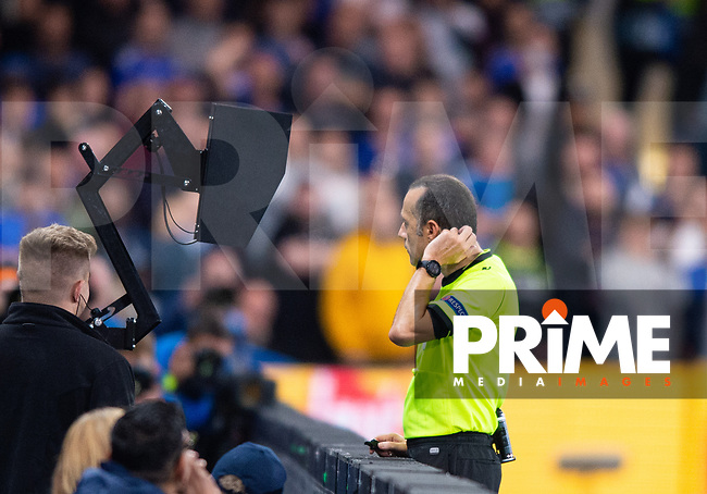 Referee Cuneyt Cakir analysing VAR footage ; and giving Chelsea penalty decision during the UEFA Champions League match between Chelsea and Valencia  at Stamford Bridge, London, England on 17 September 2019. Photo by Andrew Aleksiejczuk / PRiME Media Images.