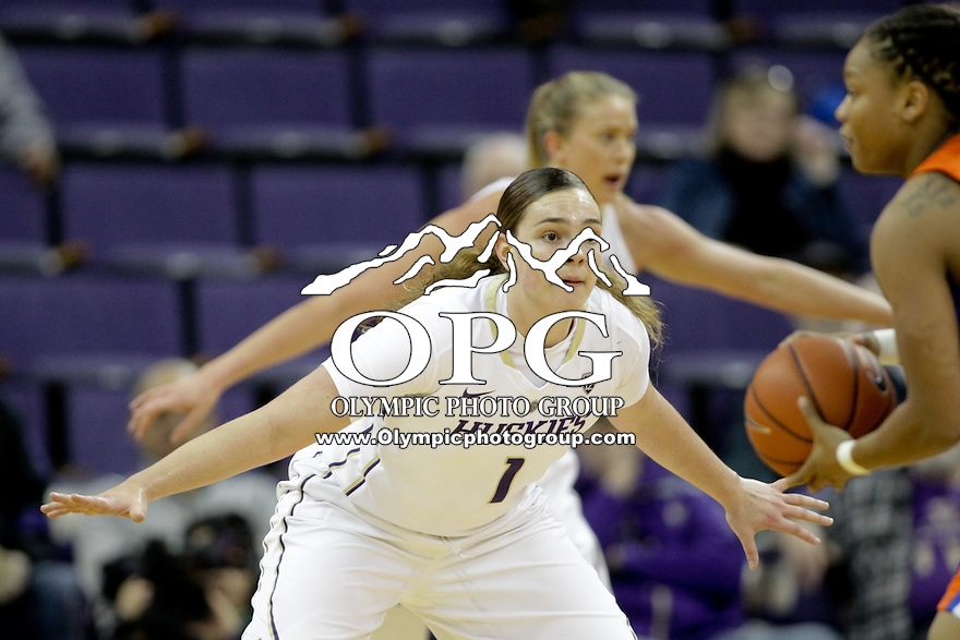 SEATTLE, WA - DECEMBER 18: Washington's #1 Hannah Johnson sets up on defense against Savannah State.  Washington won 87-36 over Savannah State at Alaska Airlines Arena in Seattle, WA.
