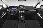 Stock photo of straight dashboard view of a 2015 Subaru Xv Hybrid 5 Door SUV