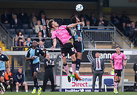 Shaun Brisley of Northampton Town & Aaron Holloway of Wycombe Wanderers go up for the ball during the Sky Bet League 2 match between Wycombe Wanderers and Northampton Town at Adams Park, High Wycombe, England on 3 October 2015. Photo by Andy Rowland.