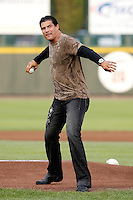 Former major leaguer Jose Canseco throws out the first pitch before a game between the Rochester Red Wings and Lehigh Valley IronPigs at Frontier Field on August 18, 2011 in Rochester, New York.  Lehigh Valley defeated Rochester 11-1.  (Mike Janes/Four Seam Images)