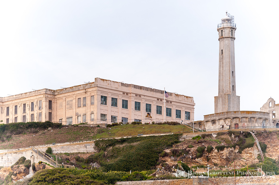 "United States, California, San Francisco. The famous Alcatraz prison island, also known as ""The Rock"". The lighthouse on top of the hill."