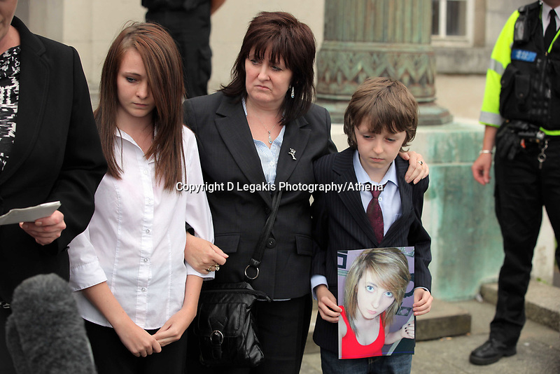 Pictured: The mother (C) Sonia of tragic teen Rebeca Aylward with her other daughter and son Jack (R) who is holding a picture of Rebecca, standing outside Swansea Crown Court while a staement is being read on their behalf. Wednesday 27 July 2011<br /> Re: The jury on the trial of 17-year-old Joshua Davies who denies murdering his 15 year old ex-girlfriend Rebecca Aylward over an alleged bet for a free breakfast has found him guilty at Swansea Crown court.<br /> Rebecca was found dead in woods in Aberkenfig, near Bridgend, south Wales, in October 2010.