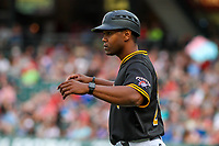 Indianapolis Indians coach Greg Picart (25) coaching third base during an International League game against the Buffalo Bisons on July 28, 2018 at Victory Field in Indianapolis, Indiana. Indianapolis defeated Buffalo 6-4. (Brad Krause/Four Seam Images)