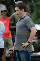 www.acepixs.com<br /> July 12, 2017 New York City<br /> <br /> Adam Devine filming the movie 'Isn't It Romantic' in Washington Square Park on in New York City on July 12, 2017.<br /> <br /> Credit: Kristin Callahan/ACE Pictures<br /> <br /> Tel: 646 769 0430<br /> Email: info@acepixs.com