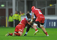 Racing 92 Cedate Gomes Sa is tackled by Scarlets' Samson Lee and Blade Thomson<br /> <br /> Photographer Ian Cook/CameraSport<br /> <br /> European Rugby Champions Cup - Scarlets v Racing 92 - Saturday 13th October 2018 - Parc y Scarlets - Llanelli<br /> <br /> World Copyright &copy; 2018 CameraSport. All rights reserved. 43 Linden Ave. Countesthorpe. Leicester. England. LE8 5PG - Tel: +44 (0) 116 277 4147 - admin@camerasport.com - www.camerasport.com