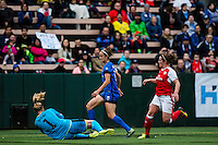 Seattle, WA - Thursday, May 26, 2016: Arsenal Ladies FC goalkeeper Emma Byrne (1) defends Seattle Reign FC midfielder Havana Solaun (19). The Seattle Reign FC of the National Women's Soccer League (NWSL) and the Arsenal Ladies FC of the Women's Super League (FA WSL) played to a 1-1 tie during an international friendly at Memorial Stadium.