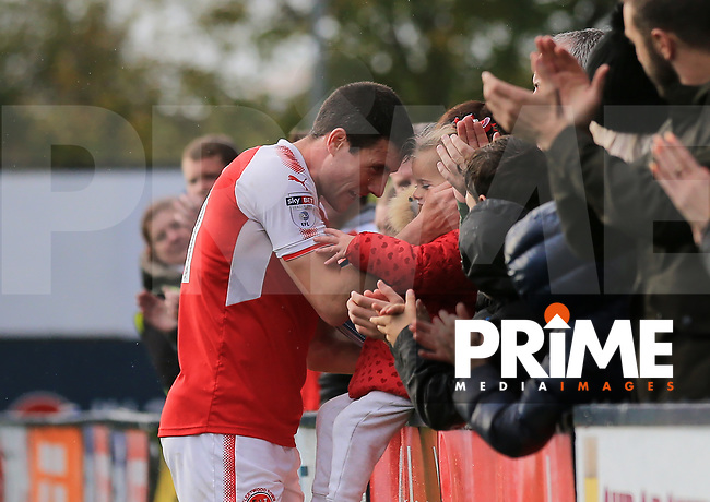 Bobby Grant of Fleetwood Town consolidates his daughter after the Sky Bet League 1 match between Shrewsbury Town and Fleetwood Town at Greenhous Meadow, Shrewsbury, England on 21 October 2017. Photo by Leila Coker / PRiME Media Images.
