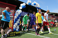 Watford Captain, Andrew Eleftheriou, leads out the rest of his team for the start of the match during Woking vs Watford, Friendly Match Football at The Laithwaite Community Stadium on 8th July 2017