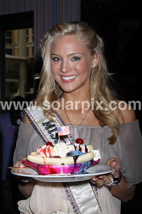 """**ALL ROUND PICTURES FROM SOLARPIX.COM**.**SYNDICATION RIGHTS FOR UK, AUSTRALIA, DENMARK, PORTUGAL, S. AFRICA, SPAIN & DUBAI (U.A.E) ONLY**.Miss USA 2009 Kristen Dalton Unveils the """"Red, White and Blue"""" Banana Split Kicking Off National Ice Cream Month at Serendipity 3 at Caesars Palace Hotel and Casino, Las Vegas, NV, USA. 30 June 2009..This pic: Kristen Dalton..JOB REF: 9380 PHZ (PRN) DATE: 30_06_2009.**MUST CREDIT SOLARPIX.COM OR DOUBLE FEE WILL BE CHARGED**.**ONLINE USAGE FEE GBP 50.00 PER PICTURE - NOTIFICATION OF USAGE TO PHOTO @ SOLARPIX.COM**.**CALL SOLARPIX : +34 952 811 768 or LOW RATE FROM UK 0844 617 7637**"""