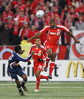 Toronto FC defender Marvell Wynne (16) heads the ball over New York Red Bulls midfielder Danleigh Borman (12). Toronto FC and the New York Red Bulls played to a 1-1 tie during a Major League Soccer match at BMO Field in Toronto, Ontario, Canada, on May 1, 2008.