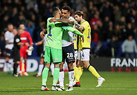 Bolton Wanderers' Josh Magennis embraces Blackburn Rovers' goalkeeper David Raya at the end of the match<br /> <br /> Photographer Andrew Kearns/CameraSport<br /> <br /> The EFL Sky Bet Championship - Bolton Wanderers v Blackburn Rovers - Saturday 6th October 2018 - University of Bolton Stadium - Bolton<br /> <br /> World Copyright © 2018 CameraSport. All rights reserved. 43 Linden Ave. Countesthorpe. Leicester. England. LE8 5PG - Tel: +44 (0) 116 277 4147 - admin@camerasport.com - www.camerasport.com