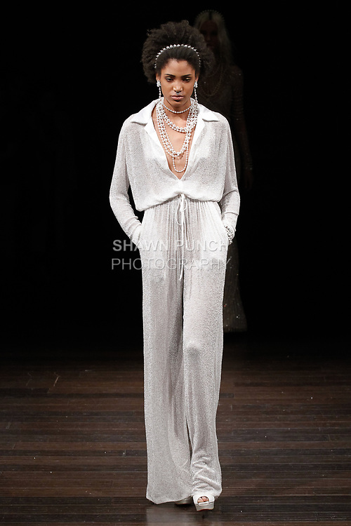 "Model walks runway in a ""Nevad"" bridal jumpsuit from the Naeem Khan Bridal Spring 2018 collection, on April 21, 2017; during New York Bridal Fashion Week."
