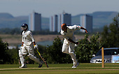 Scottish National Cricket League, Premier Div - Uddingston V Clydesdale at Bothwell Policies - Uddy (and former Scotland) bowler Paul Hoffmann bowls past Clydesdale's Kasim Farhid against a backdrop of distant Glasgow high-rise flats - Picture by Donald MacLeod - 30 May 2009