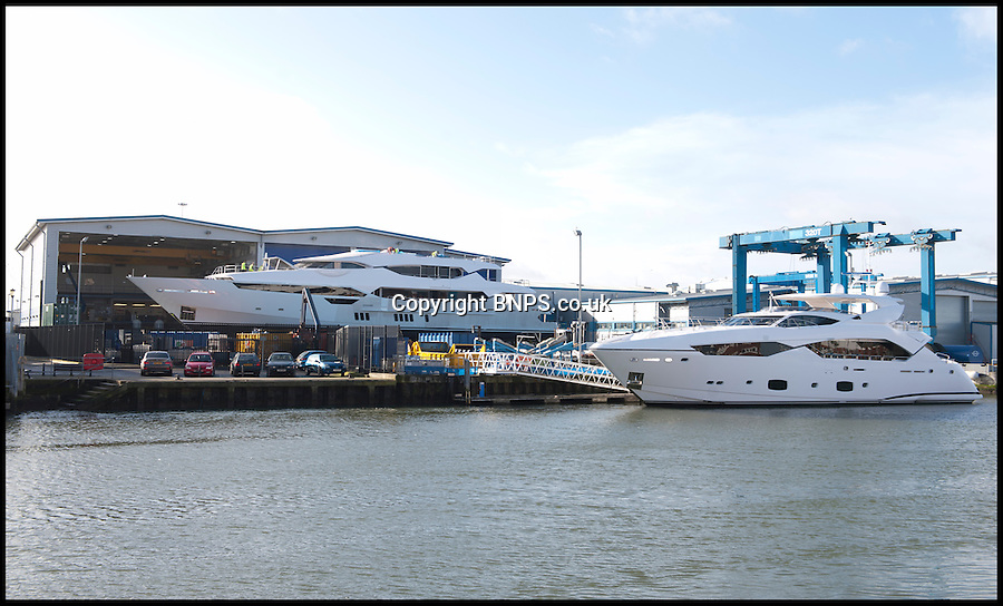 BNPS.co.uk (01202) 558833<br /> Picture: LauraJones/BNPS<br /> <br /> Former Formula 1 team owner Eddie Jordan's custom-made yacht.<br /> <br /> A precious cargo of luxury motorboats worth £25 million are loaded onto an enormous cargo ship for a piggy-back ride to their new wealthy Mediterranean owners.<br /> <br /> Seven plush powerboats made by Sunseeker carefully craned onto a special 300ft transporter ship at the company's boatyard in Poole, Dorset.<br /> <br /> The boats are destined for a number of undisclosed millionaire's resorts around the Mediterranean.<br /> <br /> Included in the shipment were two Sunseeker 28 Metre Yachts each worth £6 million plus one Predator 115 which sells for £11 million.<br /> <br /> It comes weeks after the firm unveiled the biggest boat ever built in the UK - a whopping 155ft superyacht made for Formula One mogul Eddie Jordan for an estimated £32 million.