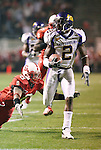 25 November 2006: East Carolina's Aundrae Allison (2) races past NC State's Jimmie Sutton III (8) on a 53 yard touchdown reception, giving ECU a 14-10 lead with only four seconds left in the first half. The East Carolina University Pirates defeated the North Carolina State University Wolfpack 21-16 at Carter Finley Stadium in Raleigh, North Carolina in an NCAA Division I College Football game.