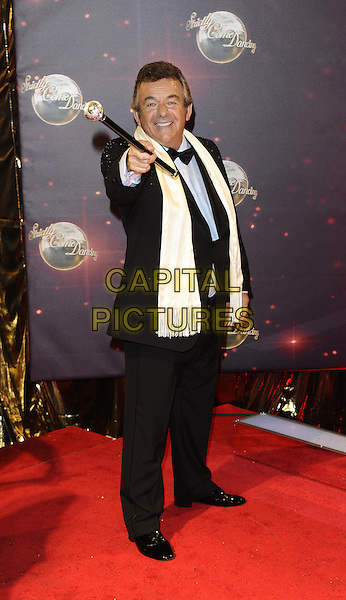 Tony Jacklin<br /> The red carpet launch for 'Strictly Come Dancing' at Elstree Studios, Borehamwood, England.<br /> September 3rd, 2013<br /> full length black white blue shirt tuxedo scarf cane pointing <br /> CAP/FIN<br /> &copy;Steve Finn/Capital Pictures