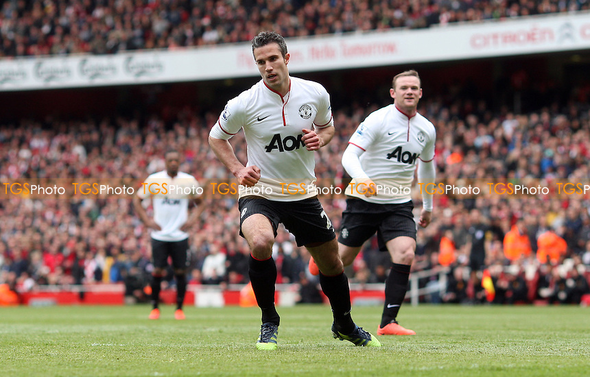 Robin Van Persie scores the 1st goal for Manchester United from the penalty spot and reels away - Arsenal vs Manchester United, Barclays Premier League at the Emirates, Arsenal - 28/04/13 - MANDATORY CREDIT: Rob Newell/TGSPHOTO - Self billing applies where appropriate - 0845 094 6026 - contact@tgsphoto.co.uk - NO UNPAID USE.