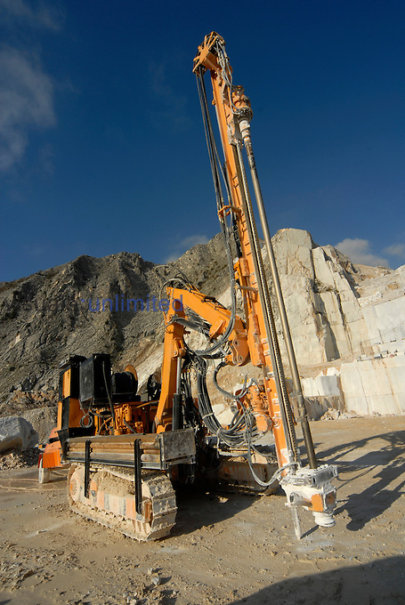 Pneumatic hole drilling machine in a marble quarry, Carrara, Alpi Apuane, Italy