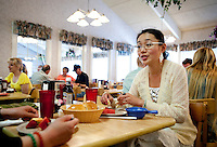 "Yue Zheng (cq, right) enjoys lunch with her mother Dongping Yuan (cq, left) at a Golden Corral restaurant in Lawton, Oklahoma, April 29, 2010. Zheng is adapting to life in the US after two years of teaching high school Chinese as part of a ""guest teacher"" program...PHOTO/ MATT NAGER"