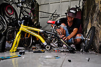 A bicycle mechanic assembles a custom made bike in a bicycle workshop in Cali, Colombia, 27 June 2014. Due to the strong, vibrant cycling culture in Colombia, with cycling being one of the two most popular sports in the country, dozens of bike workshops and artisanal, often family-run bicycle factories were always spread out through the Colombian cities. However, growing import of cheap bicycles and components from China during the last decade has led to a significant decline in domestic bicycle production. Traditional no-name bike manufacturers are forced to close down their factories, struggling to survive in the competitive bicycle market.
