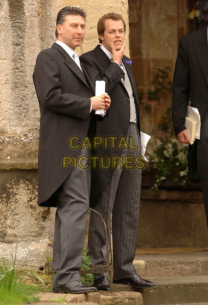 TOM PARKER BOWLES.At the wedding of Laura Parker Bowles and Harry Lopes at St Cyriac's Church, Lacock, Wiltshire, England, .May 6th 2006..full length brother .Ref: FIN.www.capitalpictures.com.sales@capitalpictures.com.©Steve Finn/Capital Pictures.