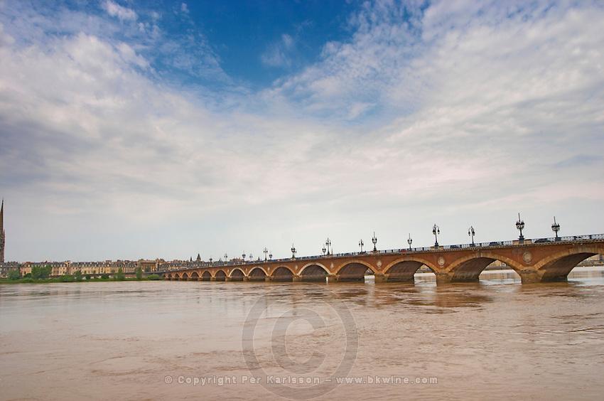 The famous old Pont de Pierre bridge across the Garonne river and the city at the far end city Bordeaux Gironde Aquitaine France