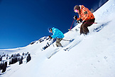 USA, Utah, man and woman skiing together in the Yellow Trail Area, Alta Ski Resort