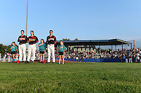 "Batavia Muckdogs Eric Fisher, Ben Holmes and Aaron Blanton stand with the ""Stars of the Game"" during the national anthem before a game against the Mahoning Valley Scrappers on August 22, 2014 at Dwyer Stadium in Batavia, New York.  Mahoning Valley defeated Batavia 2-1.  (Mike Janes/Four Seam Images)"