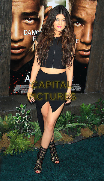 Kylie Jenner <br /> The New York Premiere of &quot;After Earth&quot; at the Ziegfeld Theatre, New York, NY., USA.<br /> May 29th, 2013<br /> full length black skirt cropped top ankle boots open toe<br /> CAP/LNC/TOM<br /> &copy;LNC/Capital Pictures