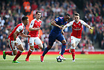 Arsenal's Aaron Ramsey tussles with Manchester United's Anthony Martial during the Premier League match at the Emirates Stadium, London. Picture date: May 7th, 2017. Pic credit should read: David Klein/Sportimage