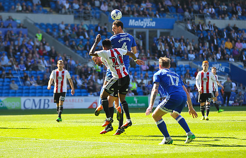 April 8th 2017, Cardiff, Wales; Skybet Championship football, Cardiff City versus Brentford; Sean Morrison  of Cardiff City (Captain) rises above Josh Clarke of Brentford FC to win the ball