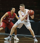 SIOUX FALLS, SD - MARCH 9:  Kyle Mangas #24 of Indiana Wesleyan holds the ball away from Kerry Smith #11 of IU Southeast at the 2018 NAIA DII Men's Basketball Championship at the Sanford Pentagon in Sioux Falls. (Photo by Dick Carlson/Inertia)
