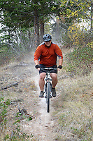 """Bob Knauss riding Echo Ridge's new singletrack trail """"Dust to Glory"""" completed in 2014."""