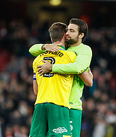 Russell Martin of Norwich City embraces Ivo Pinto of Norwich City at full time during the Carabao Cup match between Arsenal and Norwich City at the Emirates Stadium, London, England on 24 October 2017. Photo by Carlton Myrie.