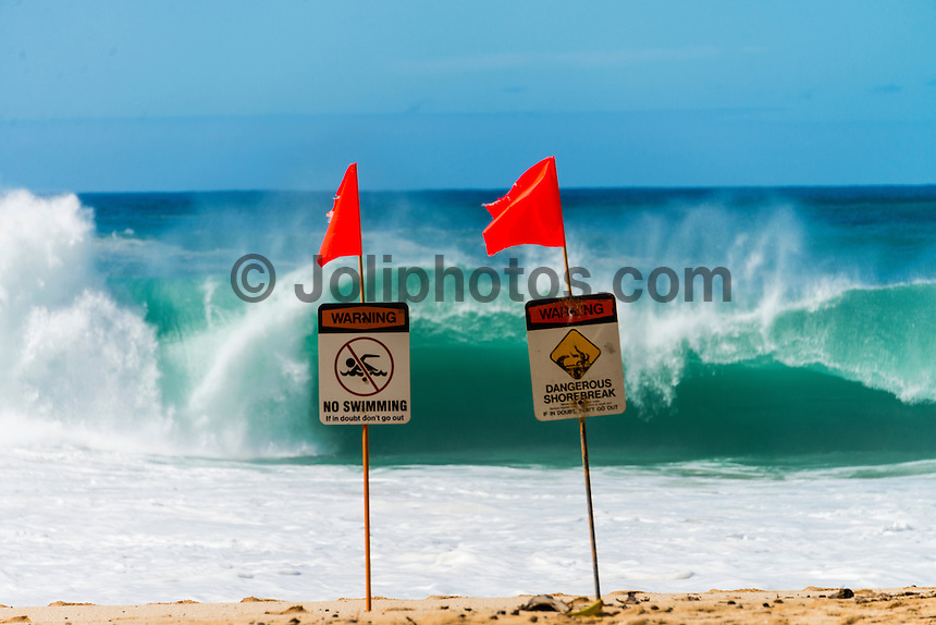 North Shore, Oahu, Hawaii (Wednesday, November 13, 2013) –  A huge North swell hit the North Shore today closing out most breaks.  The swell peaked early in the morning at around 20' before backing off during the day. Waimea Bay broke in the 12'-15' range. Local surfer Kirk Passmore (USA) was lost surfing at Alligators. Photo: joliphotos.com