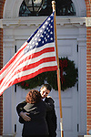 DANBURY, CT - 20 December 2012-122012EC05--    Mournders hug outside Lauren Gabrielle Rousseau's memorial service Thursday.  Rousseau is a teacher killed at Sandy Hook Elementary.  Hundreds snaked outside First Congregational Church in Danbury to pay their respects.  Erin Covey Republican-American.
