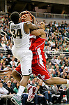 University of Wisconsin guard Jordan Taylor runs into Korie Lucious (34) of Michigan State University while driving to the basket during a Big Ten Conference game at the Breslin Center in East Lansing, MI on January 11, 2011. (Photo by Bob Campbell)