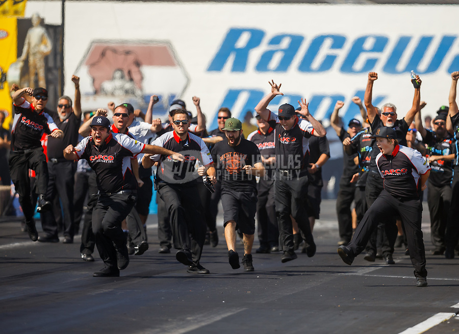 Jun 11, 2017; Englishtown , NJ, USA; Crew members for NHRA top fuel driver Steve Torrence celebrate after winning the Summernationals at Old Bridge Township Raceway Park. Mandatory Credit: Mark J. Rebilas-USA TODAY Sports