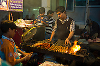 Food, meat kebabs, on sale at meat stall in Snack market at muslim Meena Bazar, in Old Delhi, India