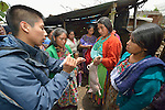 Estuardo Aguilon demonstrates how to inject a pig during a workshop at an eco-agricultural training center in Comitancillo, Guatemala. The center is sponsored by the Maya Mam Association for Investigation and Development (AMMID). Aguilon is a technical trainer for the group.