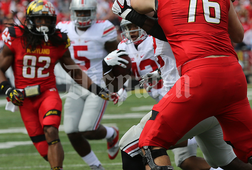 Ohio State Buckeyes linebacker Darron Lee (43) cuts through the Maryland offense after his interception in the second quarter of their game at Byrd Stadium in College Park, Maryland on October 4, 2014. (Columbus Dispatch photo by Brooke LaValley)