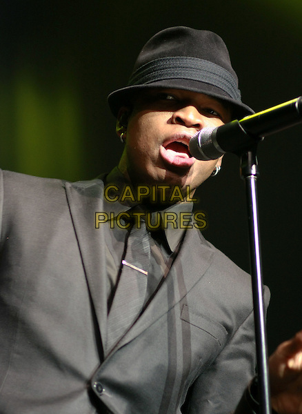 NE-YO (Shaffer Chimere Smith) .performs at the Pearl Concert Theater inside the Palms Resort Hotel and Casino, Las Vegas, Nevada, USA, .1st January 2010..Ne Yo live on stage music gig portrait headshot grey gray black suit hat microphone signing tie .CAP/ADM/MJT.©MJT/Admedia/Capital Pictures