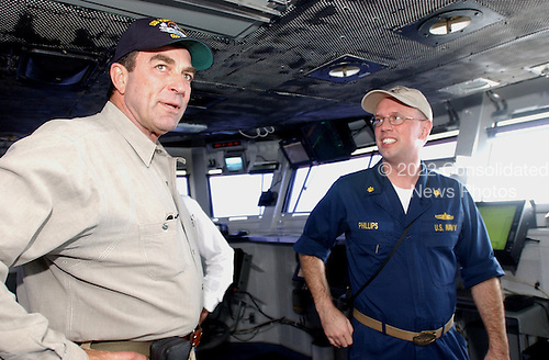 Actor Tom Selleck speaks with USS Ronald Reagan (CVN 76) Auxiliary Officer, Lieutenant Commander Clifton Phillips, of Port Saint Lucy, Florida on July 22, 2004, on the ship's bridge. Tom Selleck was aboard Reagan to welcome the ship's crew to Naval Air Station North Island, San Diego, California. Homeporting ceremonies for the United States Navy's newest and most technologically advanced aircraft carrier will host various dignitaries, including Nancy Reagan, members of the Congress, state officials and various celebrities. Reagan is commanded by Captain James A. Symonds. While in transit, the ship visited the ports of Rio de Janeiro, Brazil, Valparaiso, Chile, and Callao, Peru.  <br /> Mandatory Credit: Stefanie Broughton / USN via CNP