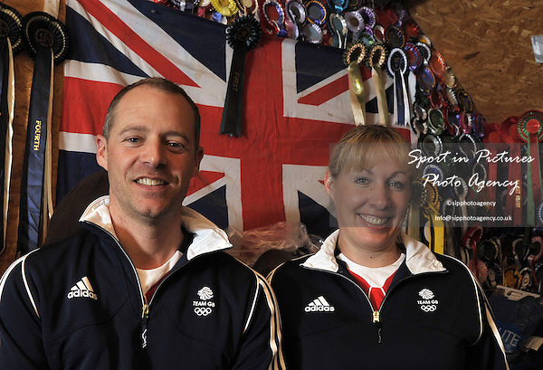 Spencer Wilton and Fiona Bigwood pose in front of the Union flag and a collection of rosettes. TeamGB announce the equestrian team for the Rio2016 Olympics. The old bull pen. Chippenham. Wiltshire. UK. 05/07/2016. ~ MANDATORY CREDIT Garry Bowden/SIPPA - NO UNAUTHORISED USE - +447837 394578