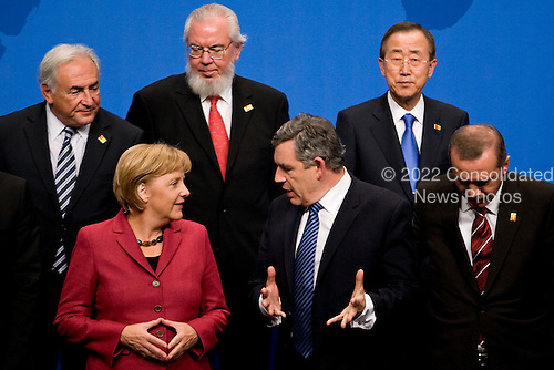 Pittsburgh, PA - September 25, 2009 -- Leaders, clockwise from left, Dominique Strauss-Kahn, managing director of the International Monetary Fund (IMF), unidentified, Ban Ki-Moon, secretary-general of the United Nations, Recep Erdogan, prime minister of Turkey, Gordon Brown, prime minister of the U.K., and Angela Merkel, chancellor of Germany, wait for a Group of 20 nations family photo on day two of the G-20 summit in Pittsburgh, Pennsylvania, U.S., on Friday, September 25, 2009. G-20 leaders are working on an accord to prevent a repeat of the worst global financial crisis since the Great Depression and ensure a sustained recovery. .Credit: Andrew Harrer / Pool via CNP