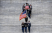 The flag-draped casket of former President George H.W. Bush is carried by a joint services military honor guard down the steps of the U.S. Capitol, Wednesday, Dec. 5, 2018, in Washington. (Sarah Silbiger/The New York Times via AP, Pool)<br /> Credit: Sarah Silbiger / Pool via CNP